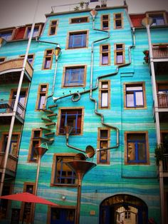 THE FUNNEL WALL - Kunsthofpassage in Dresden, Germany    (the pipes play music when it rains wow!)