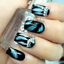 Amazing nail design! Blue feathers and dream catchers. So so pretty!