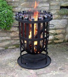 "Not a Grill, Not a Fire Pit, a ""Fire Basket"" « Luxury Housing Trends Garden Fire Pit, Diy Fire Pit, Fire Pit Backyard, Metal Fire Pit, Concrete Fire Pits, Fire Pit Swings, Fire Basket, Outdoor Fireplace Designs, Fire Pit Designs"