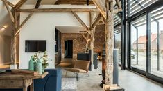 Converting an old farm into a warm industrial farmhouse with big view on an old brick wall, original wooden beams and the beautiful area around the farmhouse. Architecture Renovation, Barn Renovation, Modern Architecture, Industrial Farmhouse, Modern Farmhouse, Warm Industrial, Farmhouse Interior, Modern Family House, Old Brick Wall