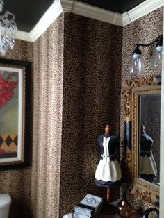 We recently converted a closet into a powder room. It is a tiny room but I decided to be a bit bodacious and get an animal print fix. .