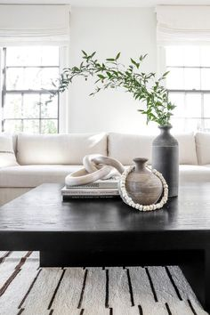 LIVING ROOM  DESIGN   ... a modern chic living room with a black and white theme with  organic branches for natural decor accents via DPAGES, an art, architecture, design publication committed to sharing all that is cool & beautiful. /// #livingroomdecor #blackandwhite #modern