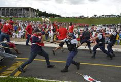 Members of the Unified Workers' Central clash with police during a protest against a proposed law which would allow companies to outsource their labor force, in front of National Congress in Brasilia on April 7, 2015. Handout . / Reuters