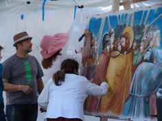 iLia Anossov (fresco) and students signing a fresco at the PDPA educational summit, Colorado