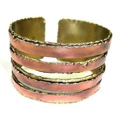 Handcrafted by South African artisans, this brass cuff has softly serrated openings that are accented with polished copper bands. The shading on this 1.5-inch wide cuff bracelet is achieved by applyin