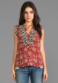 I really like this top....but $130..that's rediculous!!! I can go to Ross and find it for like $10 at most....that craziness!