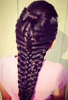 bow and feather side braids braided together in the middle