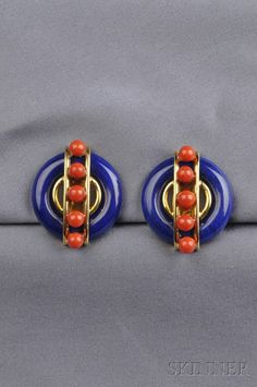 18kt Gold, Lapis Lazuli and Coral Earclips, Aldo Cipullo, Cartier, designed as lapis discs set at the center with arched gold bands, highlighted with coral beads, lg. 1 1/4 in., signed A. Cipullo, Cartier, 1973.