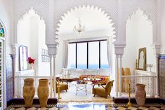 This Moroccan home, located on the coast of Tangier, could quite possibly be the ultimate beach home. I mean, how can you compete with carved archways, the arabesque details, the stained glass, colorful tile and white washed walls?! You can't. It's just perfect.