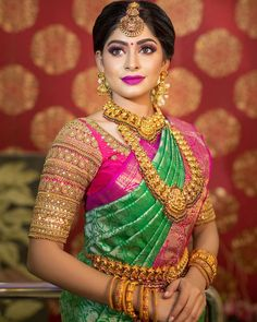 In a green color pattu / kanchipuram saree, elbow length sleeve blouse design, hip chain, long chain, head piece / maang tikka and gold jewelry Wedding Saree Blouse Designs, Saree Blouse Neck Designs, Fancy Blouse Designs, Engagement Saree, Wedding Saree Collection, Stylish Blouse Design, Bridal Sarees, Wedding Sarees, Bridesmaid Saree