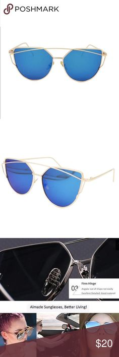 Flat Mirrored Lens Cat Eye Sunglasses Blue/Gold Gold frame and blue lens. Resin and metal. UV400. Total width 143mm. Lens width 57mm. Frame height 52mm. Bridge 18mm. Leg length 140mm. Boutique Accessories Glasses
