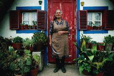 Woman standing in front of her front door.