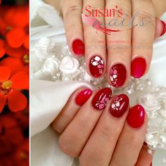 Salon nails, gel overlay on natural nails with freehand painted flowers and sugar effect.