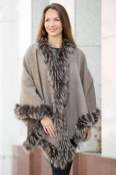 Dressing up for the theater or attending a weekend party, the Misha Reversible Alpaca Wool Cape will get you there in warmth and fashion.