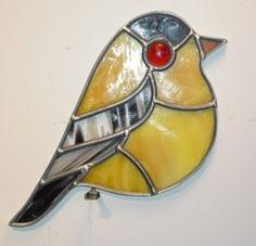 Tiny Yellow Stained Glass Bird found at Row House Gallery.
