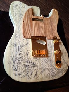 A custome telecaster made by Marlow guitars customised with artwork in Ink and tea by Carne Griffiths - The guitar will be showing in the forthcoming exhibition at Ashdown Gallery.