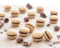 Baci di Dama ( Italian Hazelnut Cookies): two buttery hazelnut cookies sandwiched together with a dollop of dark chocolate. | aseasyasapplepie.com #hazelnut #cookies #italian #recipe