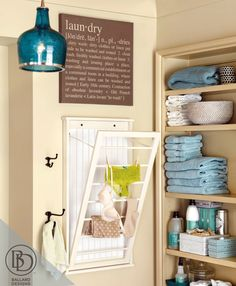 Beautify your laundry room with Ballard Designs. Forget the sign...I love the clothes rack! So much cuter than the pop up kind that stands on the floor!
