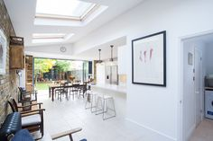 Kitchen Extension Ideas, Open Plan Living Design, Large Roof Windows, Bi-Folding Doors, Pitched Roof, Exposed Brick Wall