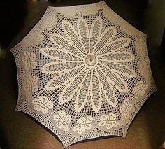 This filet crochet umbrella was spotted on a Slovak blog.