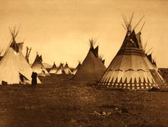 Painted Tepees - Piegan. Photographed by Edward S. Curtis, 1900. Symbolically painted tipis are frequently observed among the Piegan. Sometimes incidents in the owner's career, especially as a warrior, are depicted, but more often as in this picture, the painting is conventional, and imitative of a tipi seen by the owner in a vision.