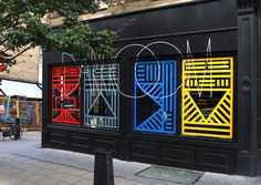 Our collaborative project with Camille Walala — T-R-I-B-A-L-A-L-A launches with an eye-popping window installation…   Darkroom #environmental #design #African-inspired