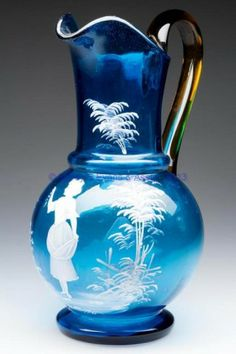 Blue glass panel optic water pitcher enamelled in the style of Mart Gregory with amber applied handle, 19th-20th Cent.