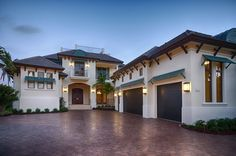 Naples Luxury Home Blog - transitional home exterior - green wood awnings - brown shingle roof