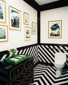 The black and white diagonal tile, the Dorothy Draper-esque chest, the bird prints, the green lacquered tray = Pow!  It's a little cold, but gorgeous!