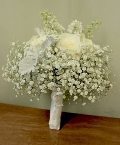Bridal bouquet of babies breath with dusty miller garden roses and fragrant white lilac