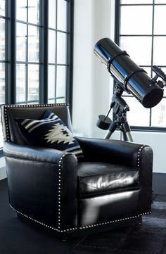 Ralph Lauren Home's black leather Colorado Club Chair - featuring distressed leather with whipstitched edges and hammered nailheads