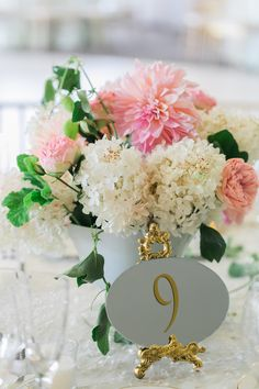 White Hydrangea and Pink Dahlia Centerpiece | photography by http://www.alexisjuneweddings.com