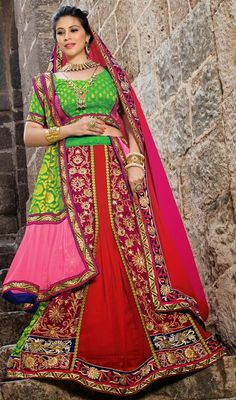 Become the object of everyone's attention donning this red embroidered chiffon and vevlet choli skirt. You could see some interesting patterns performed with moti, resham and stones work. #StunningLehengaCholi
