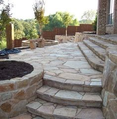 Flagstone patio with built in planters. Nice option rather than using pots.