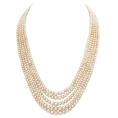 Auction Highlights - A FIVE-STRAND NATURAL PEARL NECKLACE