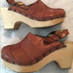 Dolce & Gabbana brown leather wooden clogs boho I'm selling a gently worn pair of Dolce & Gabbana brown leather wooden clogs size 39 1/2. Perfect for summer dresses. This style is rare and discontinued. Boho style! Dolce & Gabbana Shoes Mules & Clogs