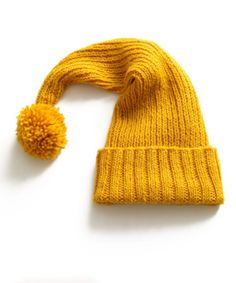 FREE Christmas Knitting Pattern - Lion Brand Seasonal Stocking Cap in the lovely Wool Ease.