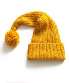 FREE Christmas Knitting Pattern - Lion Brand Seasonal Stocking Cap in the lovely Wool Ease.