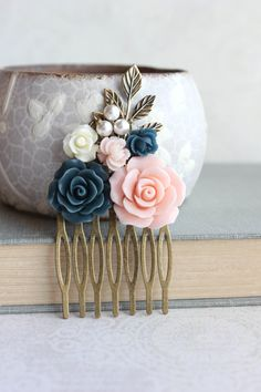 This is a beautiful floral collage hair comb in peach pink and navy!
