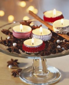 Inexpensive tea lights with trim wrapped around - add star anise, cinnamon sticks, and some beads and you have a easy, beautiful candle arrangement.