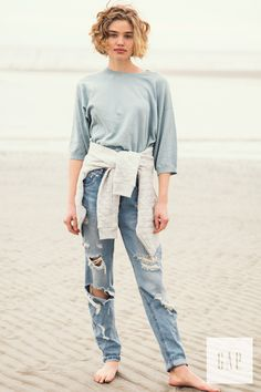 Pair a comfy sweater with denim for relaxing spring days at the beach. We love how photographer Jamie Beck captured this moment in Gap's crop sweater top. Shop it now.