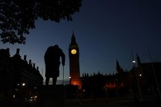 Dawn breaks behind the Houses of Parliament and the statue of Winston Churchill the day after the Brexit vote in Westminster, London June 24, 2016. REUTERS/Stefan Wermuth