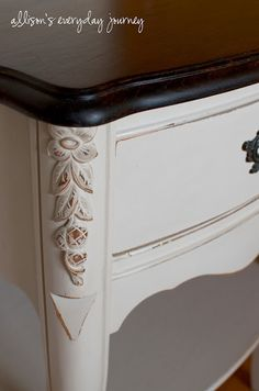 Homemade chalk paint – using Sherwin Williams Versatile Gray latex paint and Plaster of Paris. The top was stained with Minwax Dark Walnut stain.