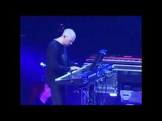 This is pretty hip, Dream Theater with Jordan Rudess and original keyboard player Derek Sherinian. Love how they both mirror sweep picking on the guitar. Self indulgent sure, but fantastic.