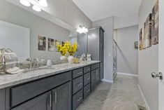 This new construction ranch-style home in Columbia, IL is perfect for young couples or empty-nesters. Home Staging Companies, Young Couples, Ranch Style, New Construction, Double Vanity, Empty, Columbia, Room, Home Decor