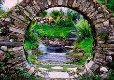 "Moon gate, built of unmortared granite blocks, built in 1996 by Dave Araneo of Massachusetts. ""It's is one of the oldest technologies around,"" Dave says. ""You build a wood form, place the stones to either side, and build up. Then you finish with a keystone and remove the form. There is a wonderful energy to these structures."""