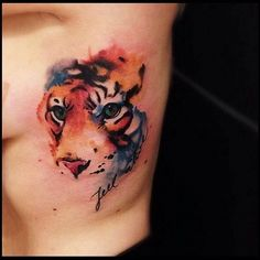 watercolor tiger by Victor Montaghini, Sao Paulo, Brazil Lion Cub Tattoo, Tiger Tattoo Thigh, Tiger Head Tattoo, Big Cat Tattoo, Cubs Tattoo, Head Tattoos, Cool Tattoos, Sleeve Tattoos, Tatoos