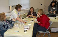 Judy, Artist Janet, Barb, Artist Betty and Artist Elena making Christmas balls.