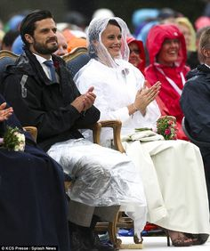 A right royal day out: Prince Carl Philip and Sofia Hellqvist cheer as they watch the show...