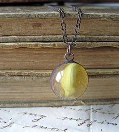 Clearly visible vintage marble necklace.